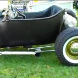 black primered, bobtail T-bucket with piecrust slicks