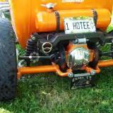 Linda McDonald's low-slung orange T-bucket roadster with independent rear suspension and custom windshield posts.